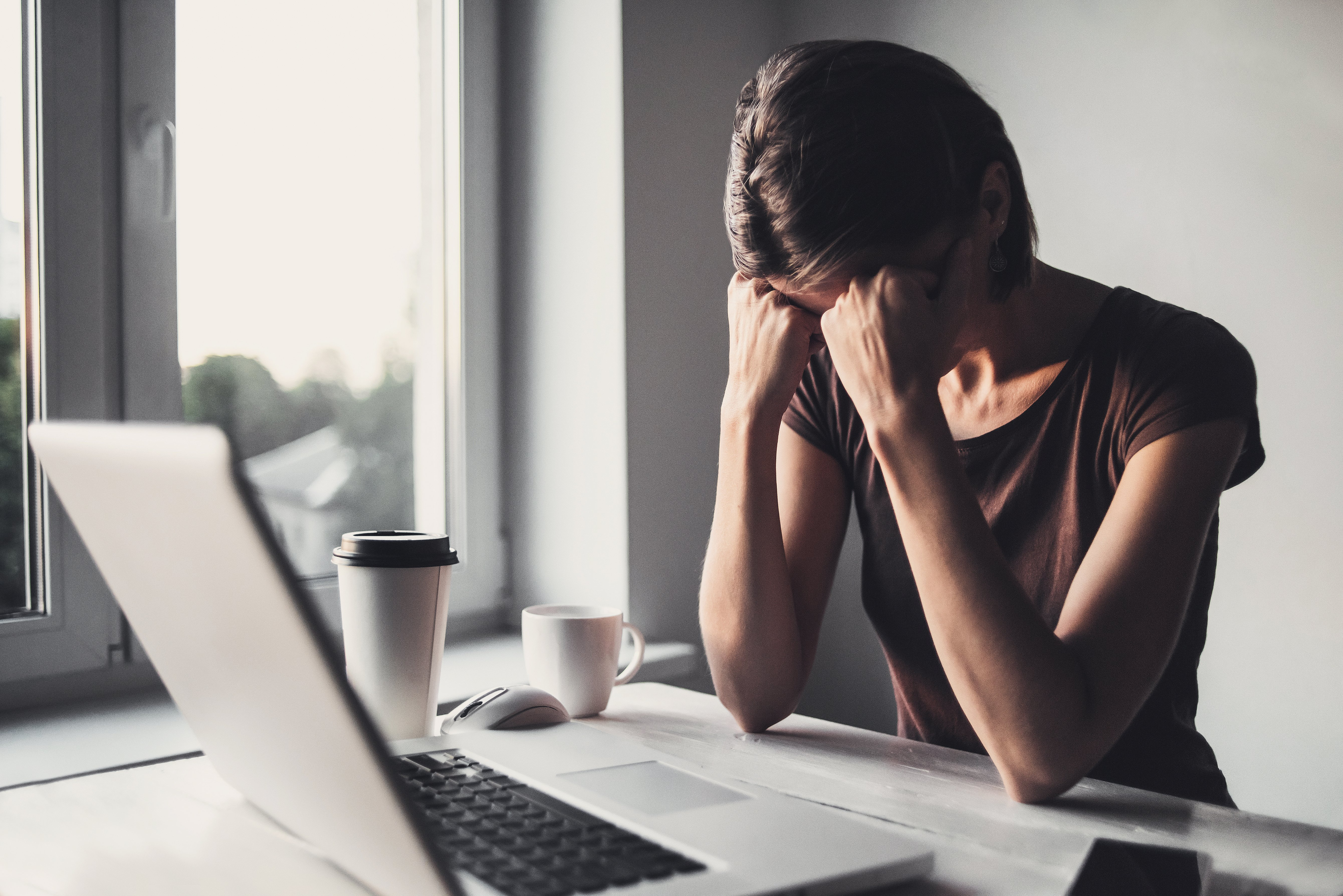Businesswoman having headache after hard work